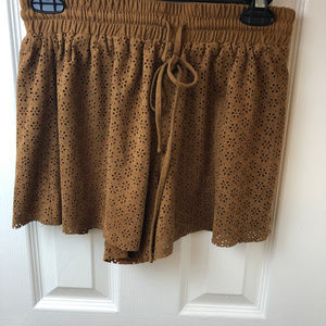 Miami perforated faux suede brown shorts.